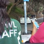 Staff driving carts and woman on phone