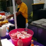 Man cooking food at event